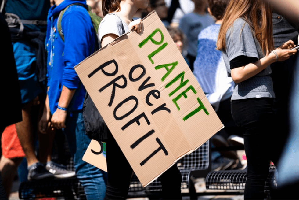 Planet over profit climate change protest sign