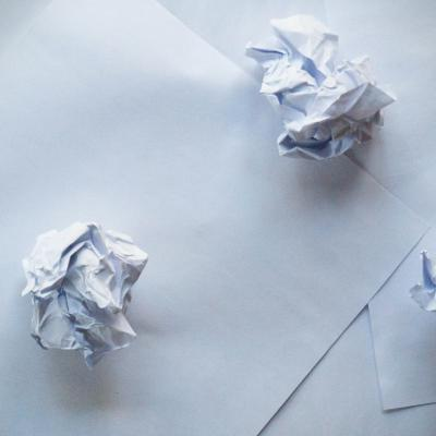 Sheets and crumpled balls of paper