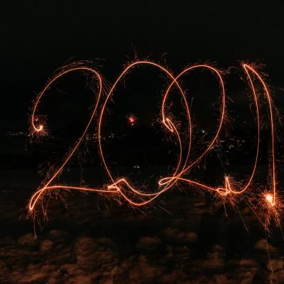 Fireworks and sparklers showing 2021 against a night sky